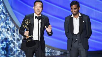 LOS ANGELES, CA - SEPTEMBER 18:  Actor/writer Aziz Ansari (R) and writer Alan Yang accept Outstanding Writing for a Comedy Series for the 'Master of None' episode 'Parents' onstage during the 68th Annual Primetime Emmy Awards at Microsoft Theater on September 18, 2016 in Los Angeles, California.  (Photo by Kevin Winter/Getty Images)