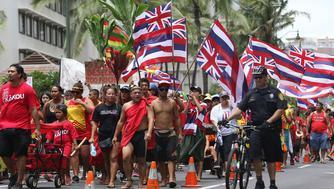 Thousands of Aloha Aina Unity marchers head toward Kapiolani Park from Saratoga Road. 9 aug 2015. photograph by Cory Lum/Civil Beat