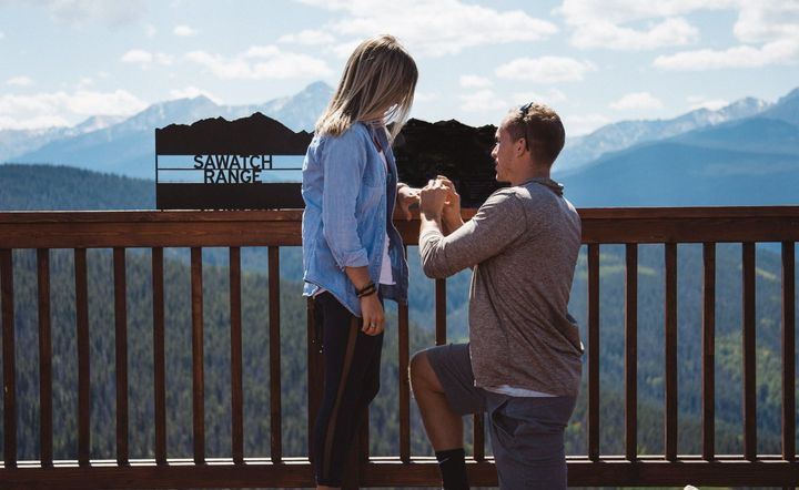 A proposal with a breathtaking view of the Rocky Mountains.