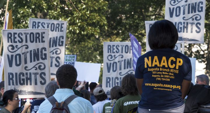 Various labor unions and progressive organizations protest on Capitol Hill, calling for the restoration of the Voting Rights