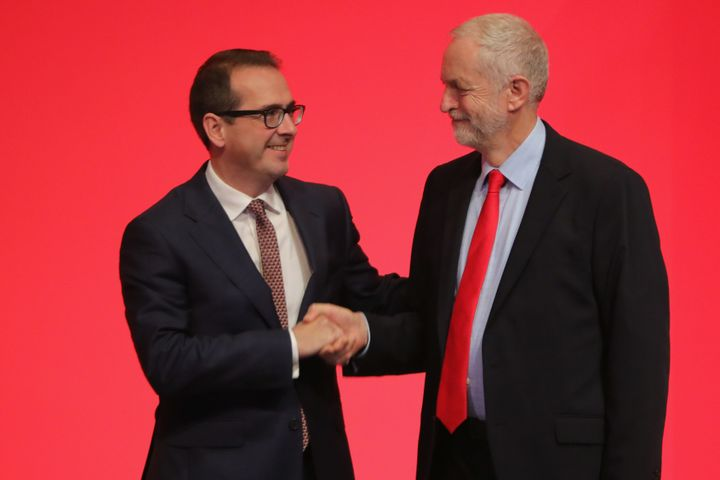 Owen Smith shakes hands with Jeremy Corbyn MP ahead of the leadership election results Saturday.