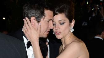 CANNES, FRANCE - MAY 20:  Director Guillaume Canet (L) and actress Marion Cotillard attend the 'Blood Ties' Premiere during the 66th Annual Cannes Film Festival at Grand Theatre Lumiere on May 20, 2013 in Cannes, France.  (Photo by Pascal Le Segretain/Getty Images)
