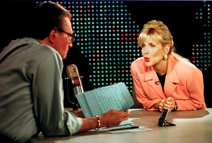 Gennifer Flowers blows a kiss to Larry King during an interview. Former President Bill Clinton admitted to having an affair w