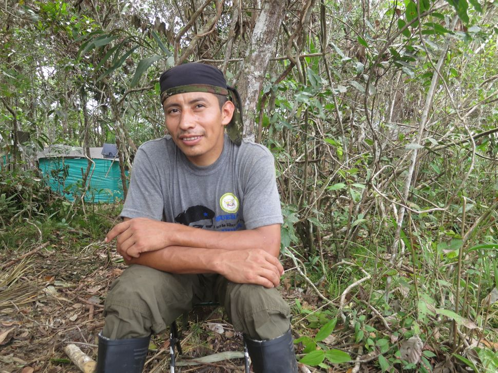 FARC fighter Roberto Méndez sits outside a guerrilla camp near where the FARC held its 10th conference, in the Yari Pl