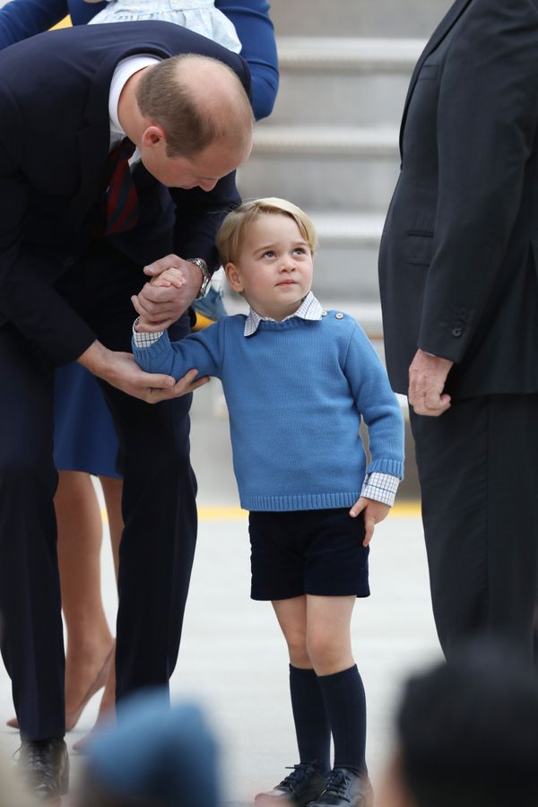 Prince George wore blue, like his father, mother and sister.