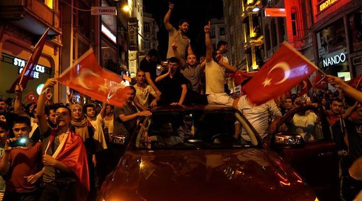 People chant slogans during a pro-government rally in Istanbul's Taksim Square.