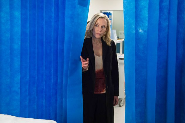 Stella Gibson (Gillian Anderson) waits as medics try to save her suspect, Paul