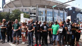 People gather outside the football stadium as the NFL's Carolina Panthers host the Minnesota Vikings, to protest the police shooting of Keith Scott, in Charlotte, North Carolina, U.S., September 25, 2016.  REUTERS/Mike Blake
