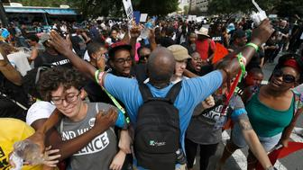 Marchers rally outside Bank of America stadium during an NFL game to protest the police shooting of Keith Scott in Charlotte, North Carolina, U.S. September 25, 2016.  REUTERS/Jason Miczek