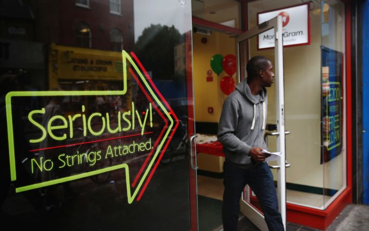 A man walks out of a payday loan store in London on Oct. 3, 2013.