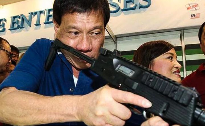 President Duterte displays his gun wielding skills.