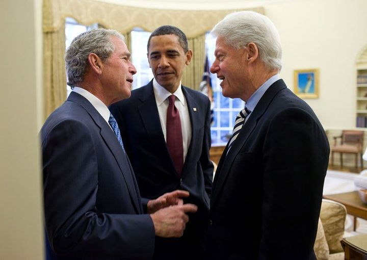 Pres. Bush chatting with Pres. Clinton as Obama watches during a visit to the White House.