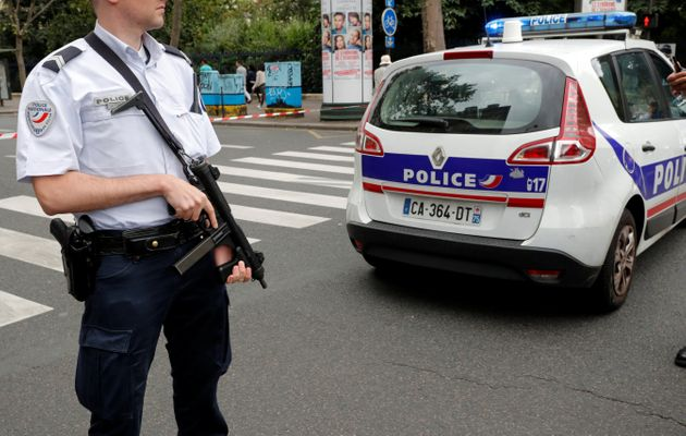 French police secure the area next to the Saint-Leu church during a security operation on Saturday in...