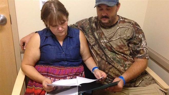 Jillian and Glen Coleman look over counseling and group therapy schedules at Valley Health in Huntington, West Virginia. Like