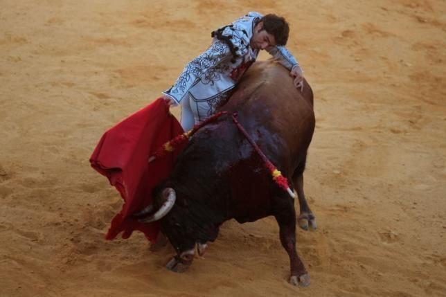 Spanish bullfighter Cayetano Rivera performs a pass to a bull during a ''Corrida Goyesca'' bullfight in Ronda, southern Spain