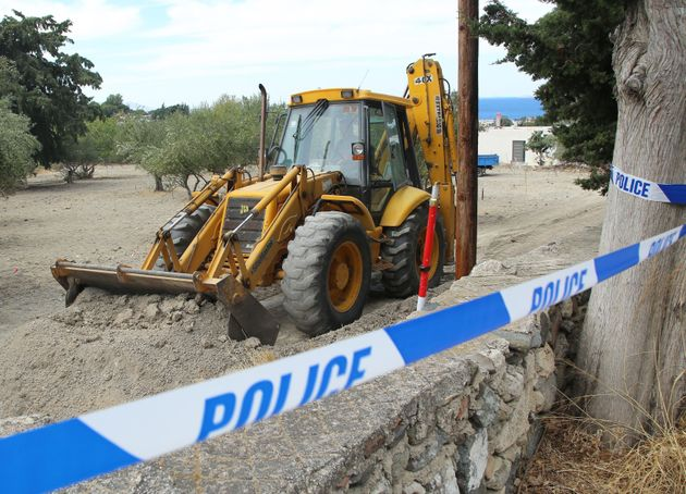 Police use a digger to investigate theolive