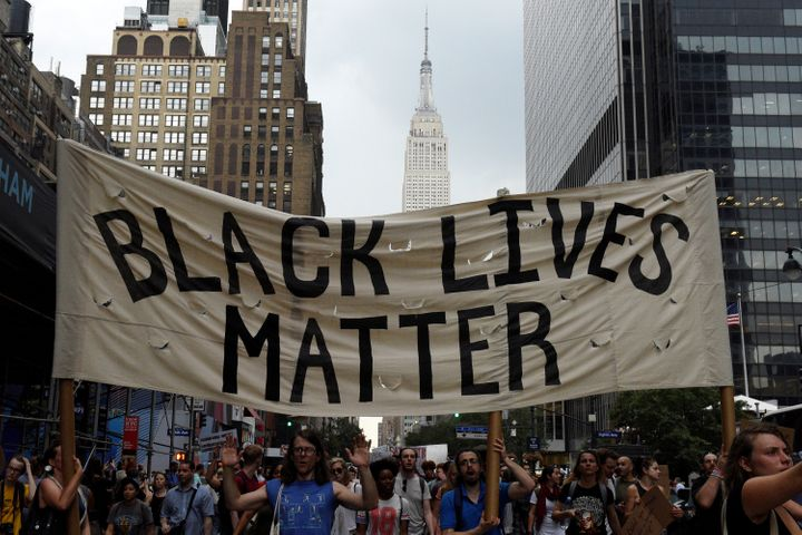 People take part in a protest against the killings of black men by police.