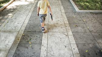 Little boy with toy gun
