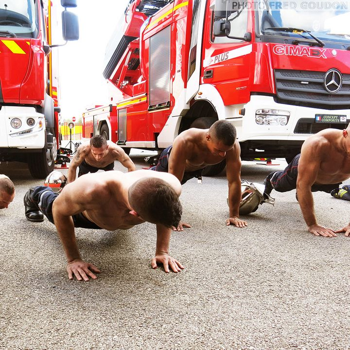 Firefighters doing push-ups for the calendar.