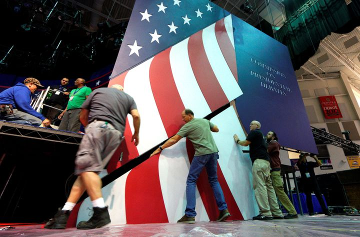 Workers install part of the stage for the first U.S. presidential debate at Hofstra University in Hempstead, New York, o
