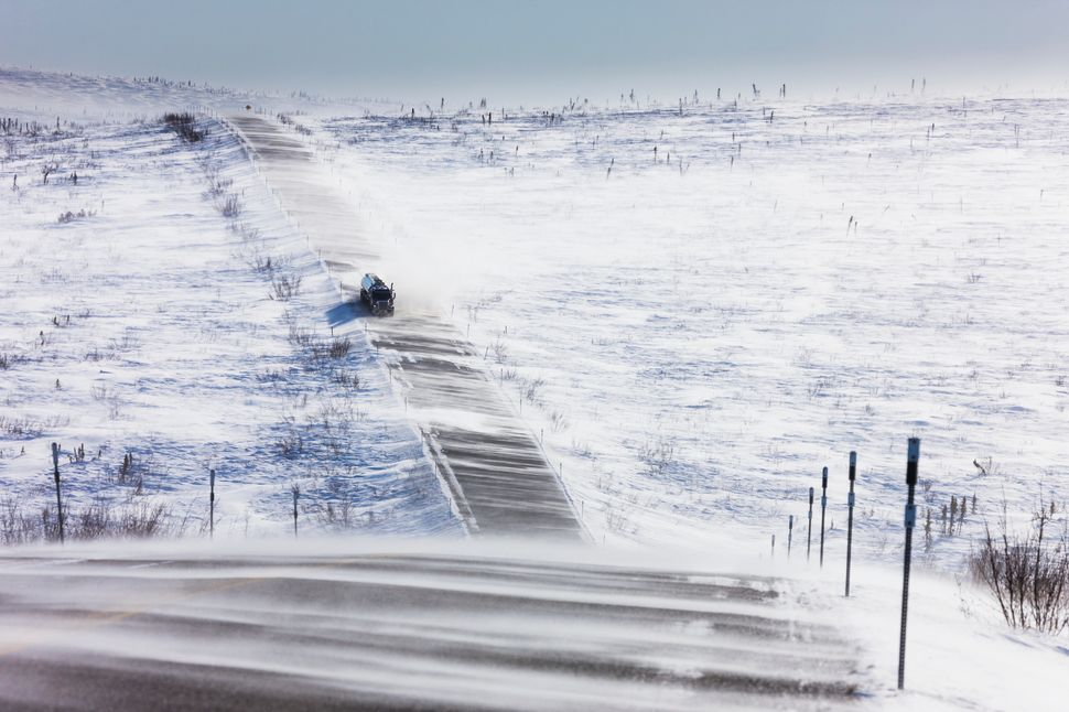 "Snow blows across the remote and <a href=""https://en.wikipedia.org/wiki/Dalton_Highway"" target=""_blank"">primitive J"