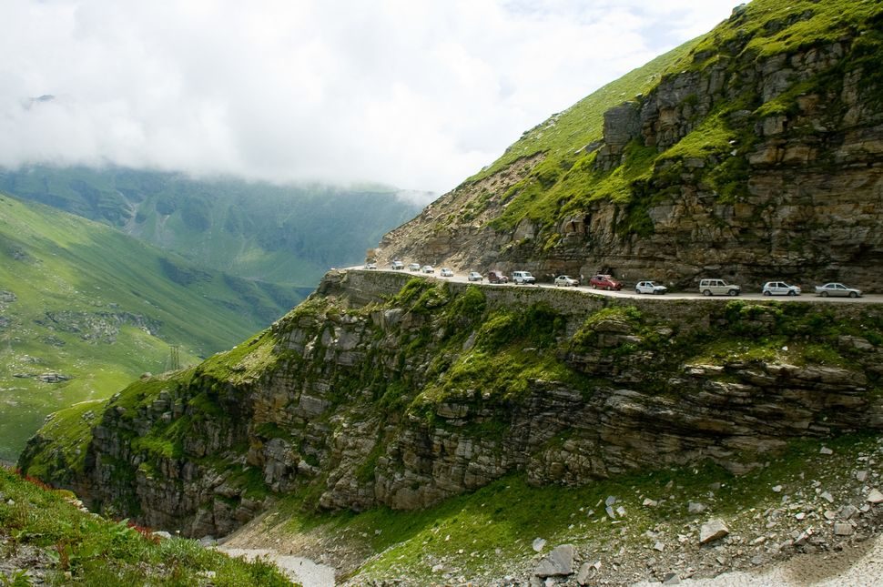The road to Rohtang Pass gives travelers no option to pull over as they wait their turn.