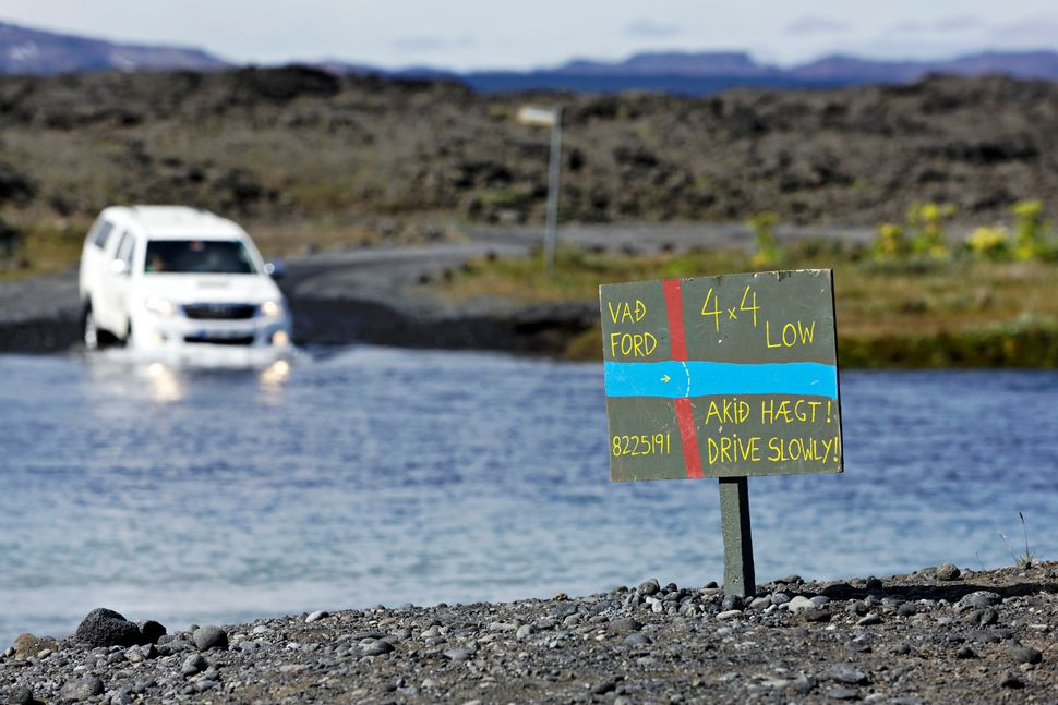 "A car attempts a water crossing on Route 88 in the Iceland highlands. The remote dirt road <a href=""http:"
