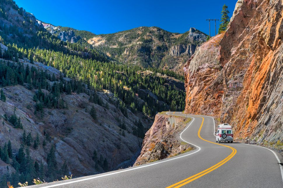 "Between Silverton and Ouray, Colorado, the Million Dollar Highway climbs three high mountain passes. ""Forget standard dr"