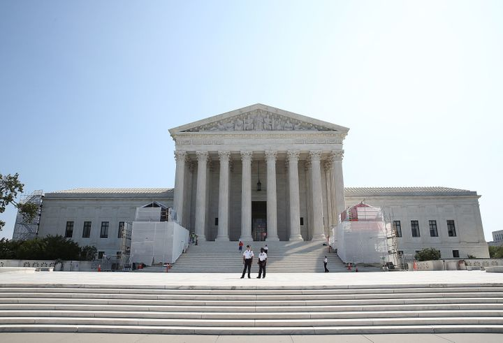 Guards stand in front of the U.S. Supreme Court, September 7, 2016 in Washington, D.C.