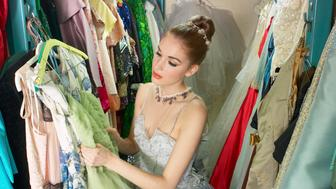 Ballerina looking at costumes