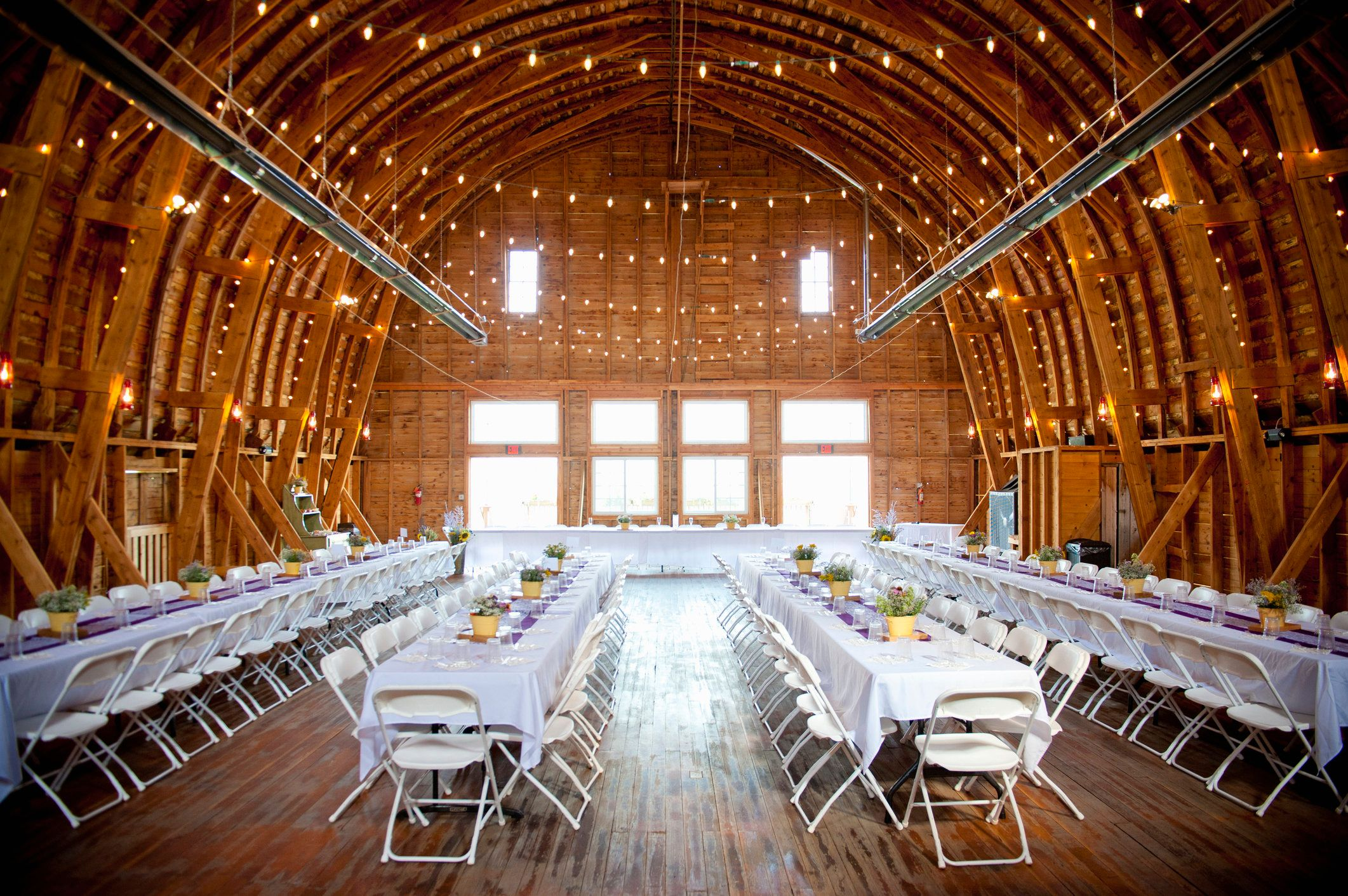 barn interior set up for a wedding reception
