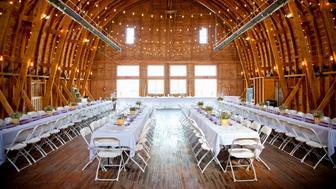 barn interior set up for a wedding reception