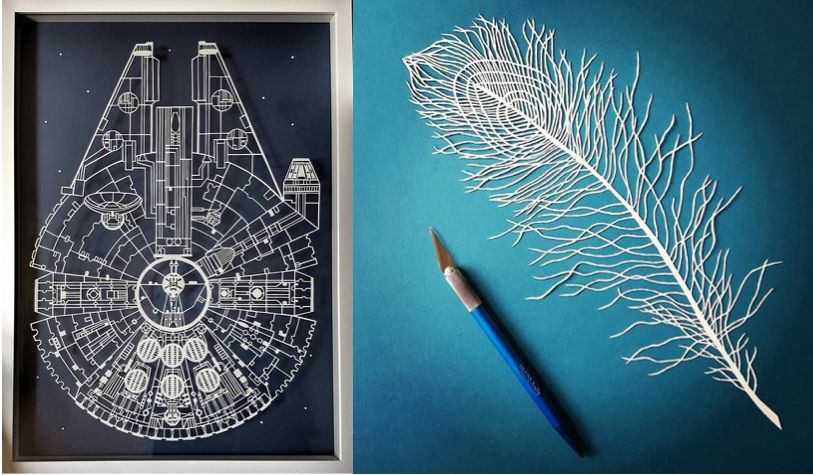 A cutout of the Millennium Falcon, a spacecraft featured in Star Wars, is seen left of a paper feather and an X-Acto knife th