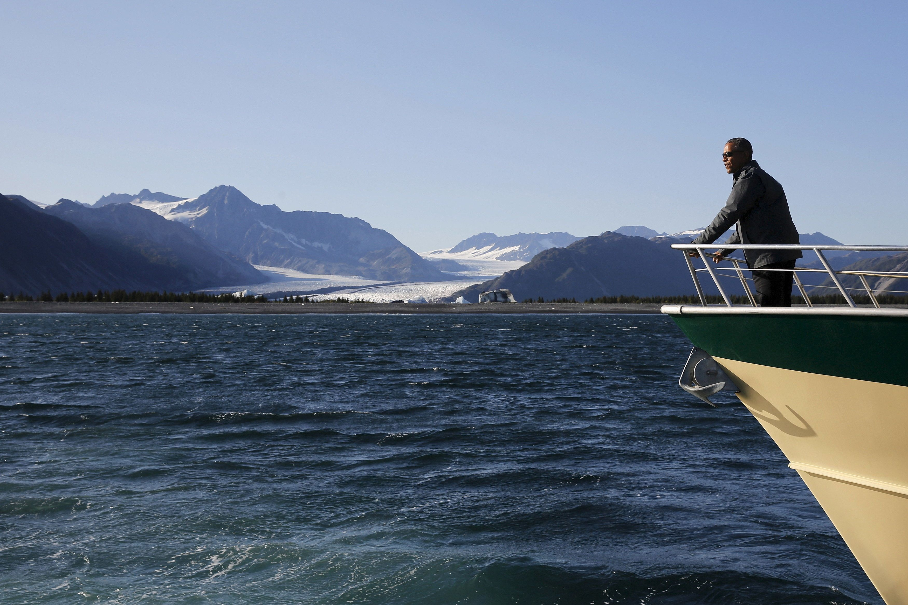 U.S. President Barack Obama views Bear Glacier on a boat tour of Kenai Fjords National Park in Seward, Alaska September 1, 2015. Obama on Tuesday proposed a faster timetable for buying a new heavy icebreaker for the U.S. Arctic, where quickly melting sea ice has spurred more maritime traffic and the United States has fallen far behind Russian resources. REUTERS/Jonathan Ernst