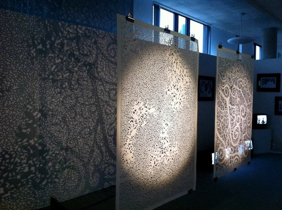 These paper sheets, seen speckled with cutout leaves, resemble intricate tapestries that can be placed before a window to hig