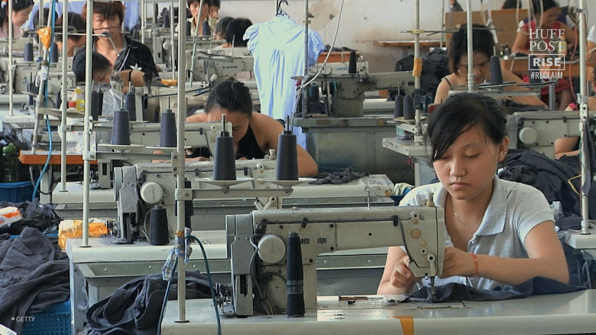 MS Rows of people at sewing machines in clothing factory  Ningbo Zhejiang China