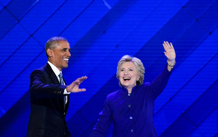 Hillary Clinton joins President Barack Obama on stage after his speech to the Democratic National Convention on July 27,