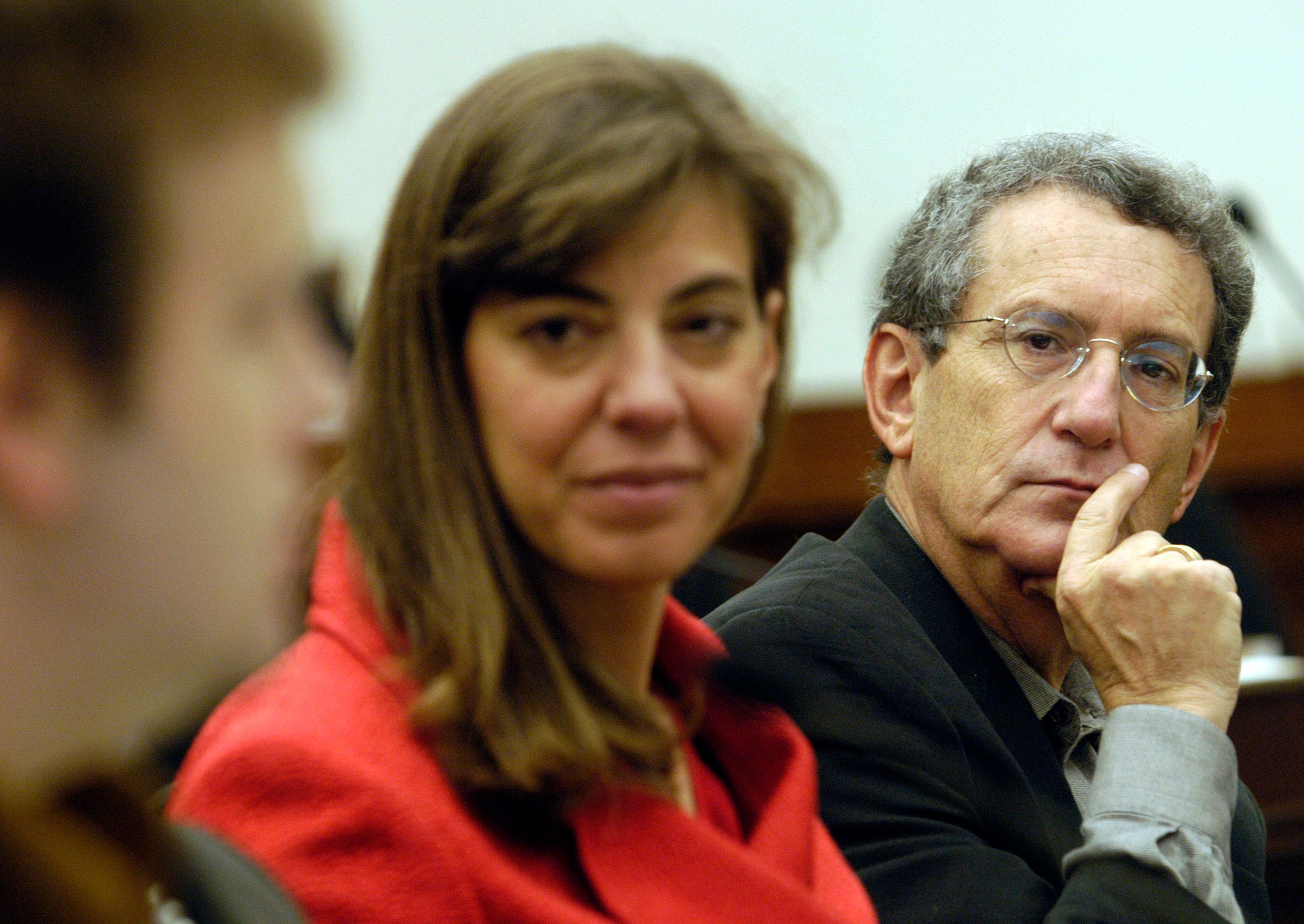UNITED STATES - NOVEMBER 04:  Stan Greenburg, an advisor to the Kerry campaign and pollster, with The Israel Project president Jennifer Laszlo Mizrahi, watches pollster Frank Luntz speak at a forum on the 2004 elections, sponsored by the The Israel Project, in the Rayburn office building.  (Photo By Chris Maddaloni/Roll Call/Getty Images)