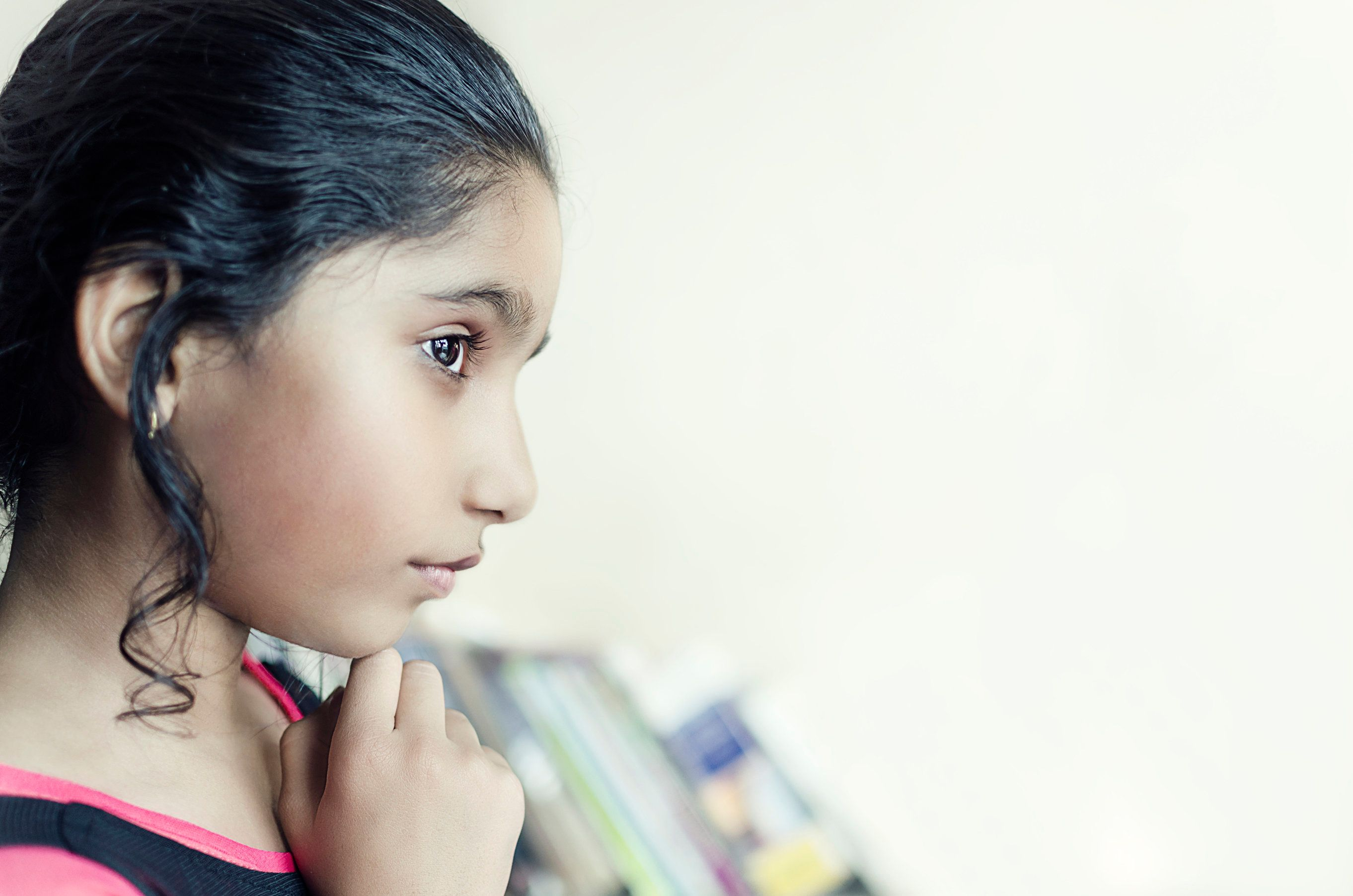 brunette  indian asian girl child hand on chin side view