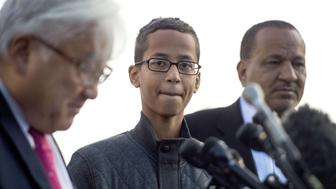 Ahmed Mohamed (C), a 14-year-old high school student who was arrested after he brought a homemade clock to his Irving, Texas high school to show his teachers and was later accused of having a 'hoax bomb', stands with his uncle Aldean Mohamed (R) and Congressman Mike Honda, R-California, during a press conference on Capitol Hill in Washington, DC, October 20, 2015.  Ahmeds detention played into national debates about Islam, immigration and ethnicity. Ahmed visited the White House Monday evening following a personal invitation from President Barack Obama. Ahmed, 14, attended the White House's Astronomy Night, along with other students, teachers, scientists and astronauts.  AFP PHOTO/JIM WATSON        (Photo credit should read JIM WATSON/AFP/Getty Images)