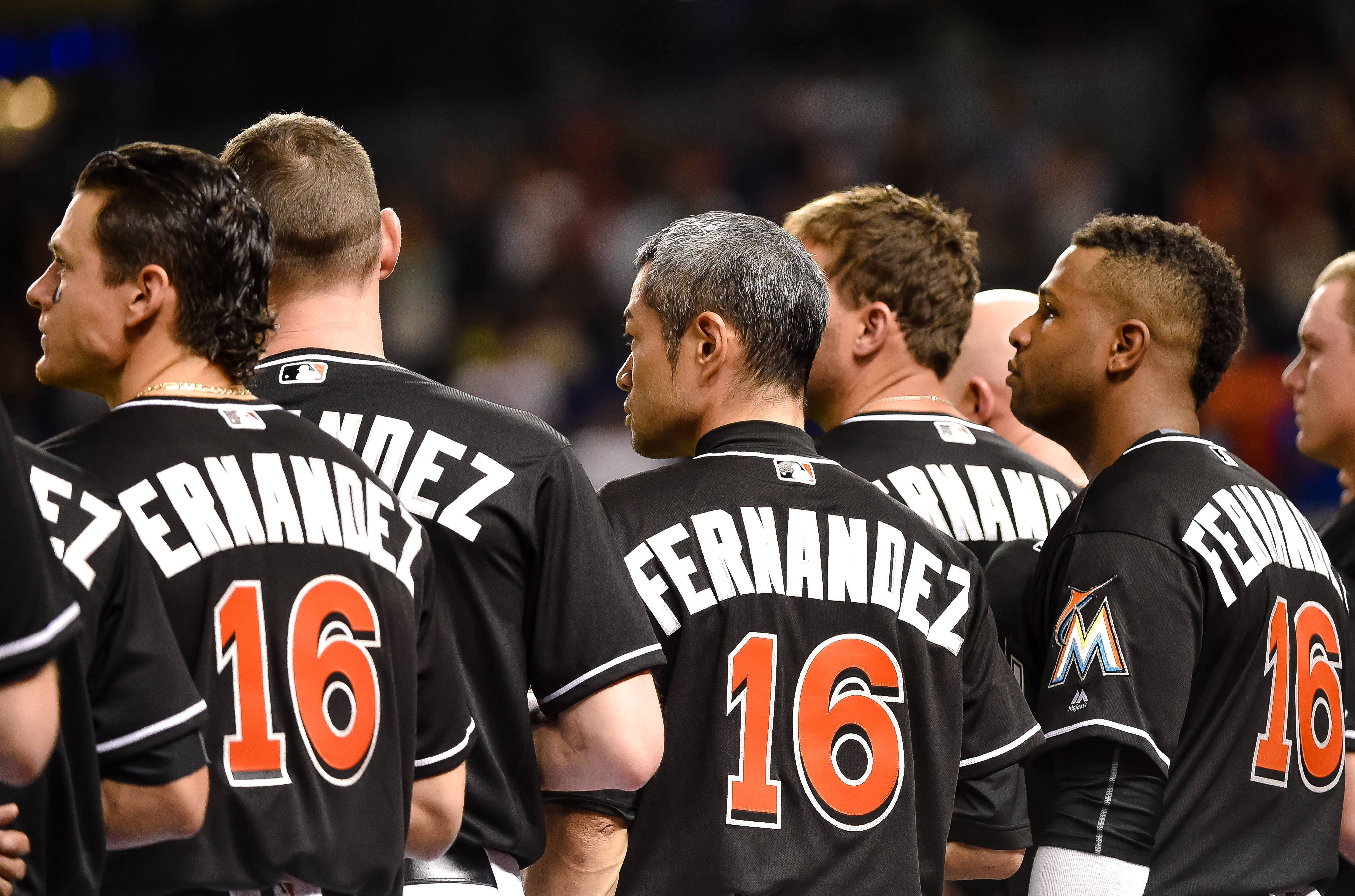 Sep 26, 2016; Miami, FL, USA; Miami Marlins players wear number 16 on their jerseys in honer of Marlins starting pitcher Jose Fernandez who passed away from a boating accident over the weekend prior to their game against the New York Mets at Marlins Park. Mandatory Credit: Steve Mitchell-USA TODAY Sports