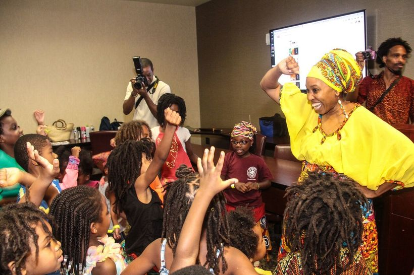 Queen Taese and students at Liberated Minds