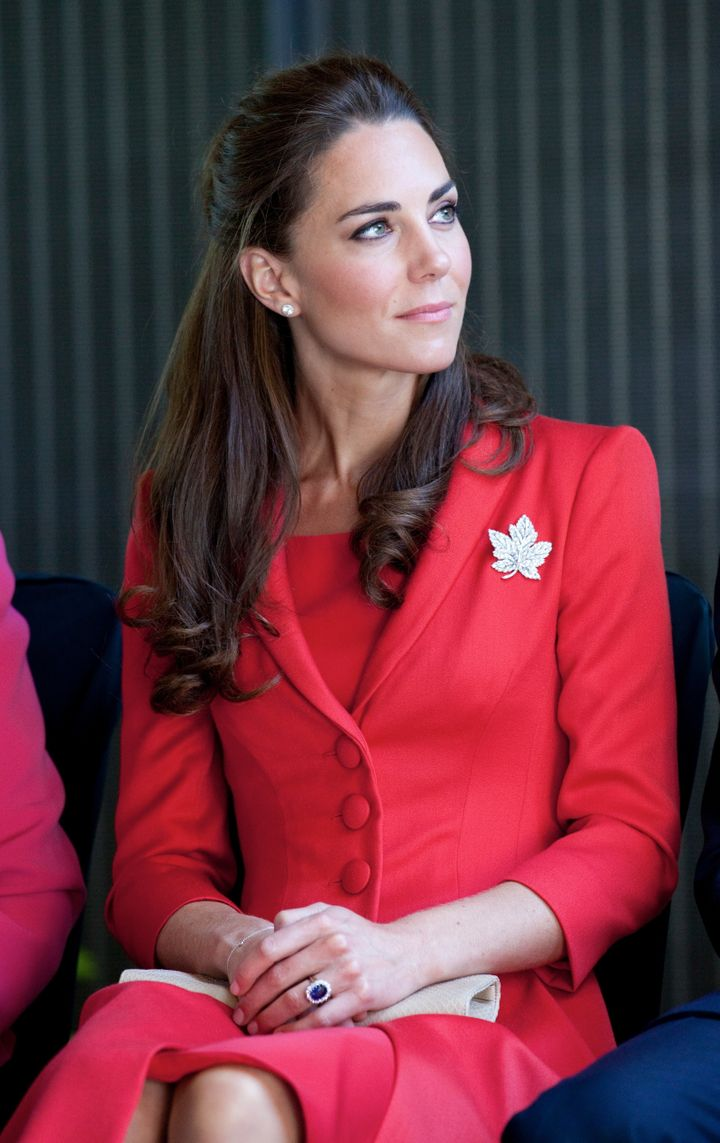 Kate wearing the pin (and red!) in 2011.