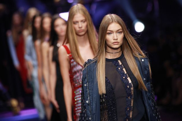 Gigi Hadid walks the runway at the Versace show during Milan Fashion