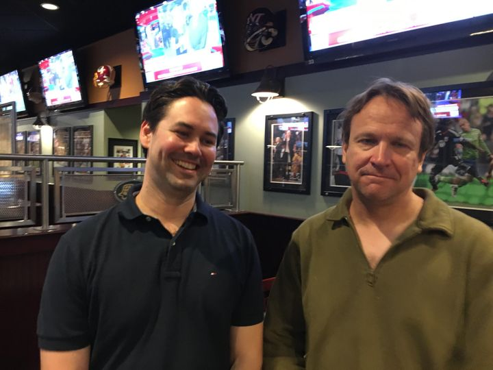 John Blair (left) and his friend Markus Rose, both Democrats, attended the debate-viewing party without realizing Genera