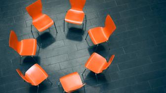Circle of empty chairs