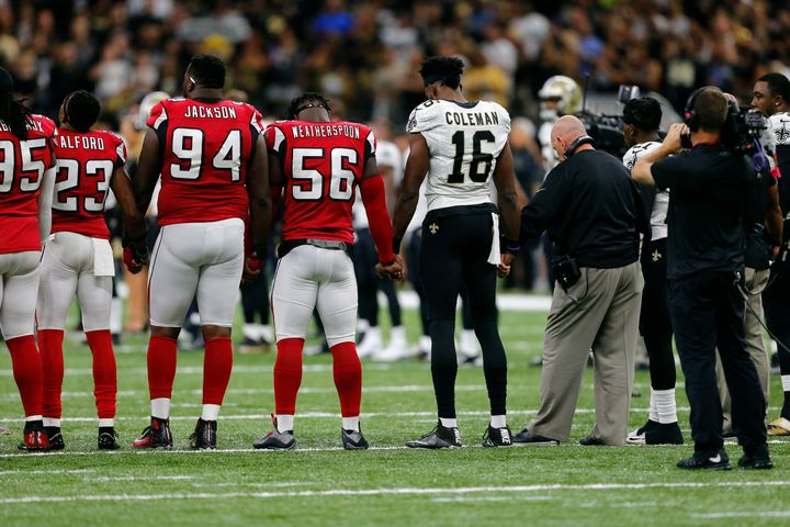 New Orleans Saints and Atlanta Falcons players form a unity circle before an NFL football game in New Orleans on Sept. 26.