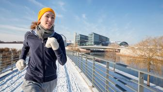 Woman jogging in winter