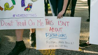 UNITED STATES - MAY 16 - Protestors gather across the street from the North Carolina state legislative building as they voice their concerns over House Bill 2, in Raleigh, N.C., Monday, May 16, 2016. House Bill 2, also known as the Bathroom Bill, which requires transgender people to use the public restroom matching the sex on their birth certificate, has received the attention of national media and the White House. (Photo By Al Drago/CQ Roll Call)