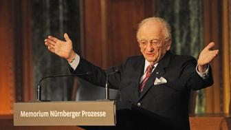 Former chief prosecutor Benjamin Ferencz addresses guests during the inauguration of the new information and documentation center 'Memorial Nuremberg Trials', in Nuremberg, southern Germany, on November 21, 2010. The exhibit is located in the attic above courtroom 600 where 21 top Nazis including Hermann Goering and Rudolf Hess went on trial on November 20, 1945, in full view of the world's, and Germany's, media. The courtroom is still in use but when not, members of the public can still enter, and visitors to the new exhibit can peek through small windows and see where the historic events of 1945-6 unfolded. The German city of Nuremberg was associated like no other with the Nazis. It was here that they created the main race laws against Jews and where their enormous party rallies took place. AFP PHOTO POOL / ARMIN WEIGEL (Photo credit should read ARMIN WEIGEL/AFP/Getty Images)